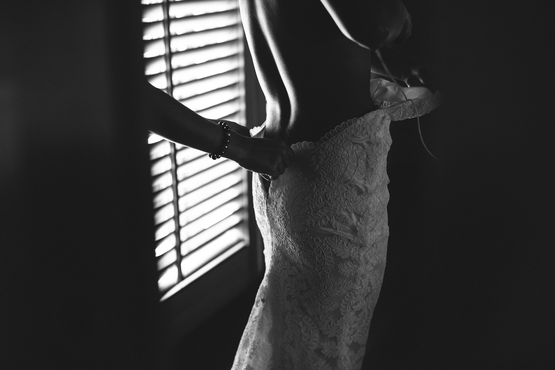 Four Seasons Bora Bora Wedding - Zipping gorgeous dress up