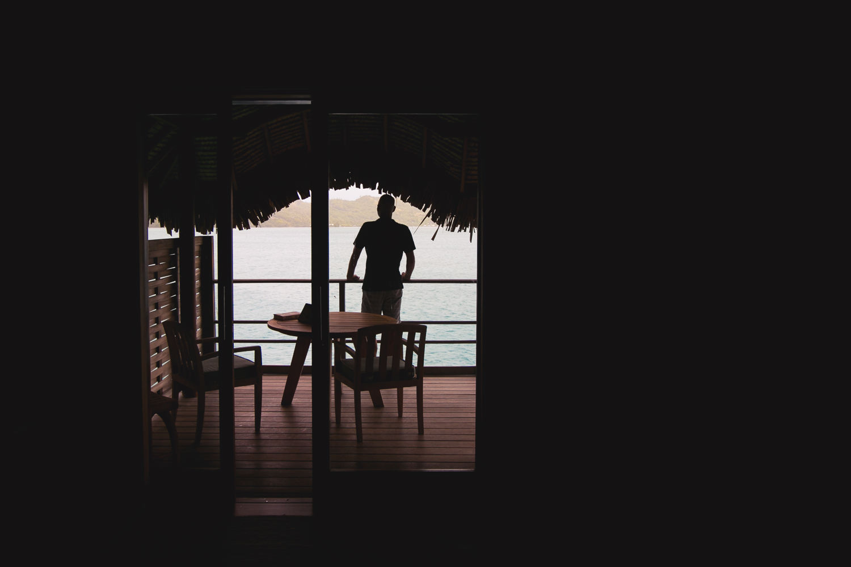 Four Seasons Bora Bora Wedding - Groom through the window