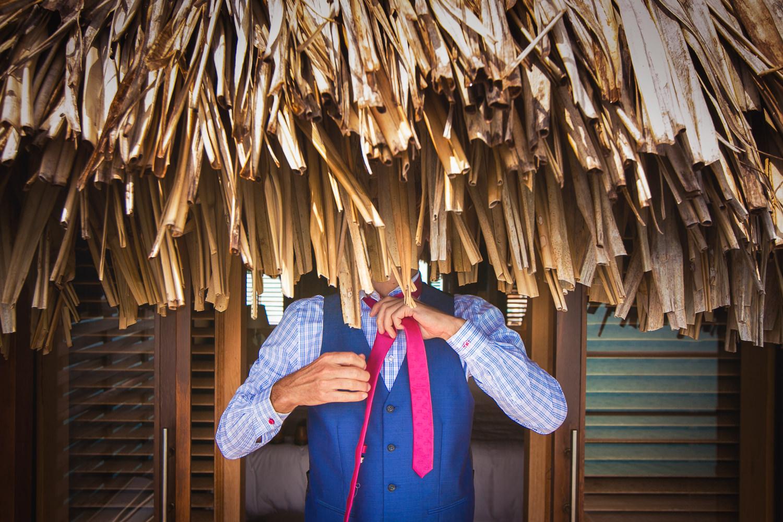 Four Seasons Bora Bora Wedding - Groom putting on his tie