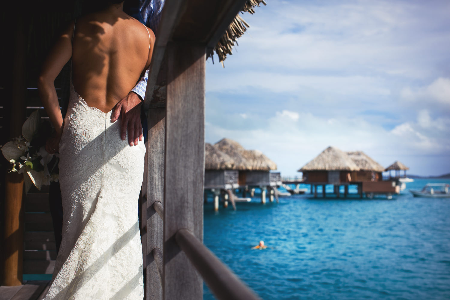 Four Seasons Bora Bora Wedding - Hands on each other by the gorgeous view