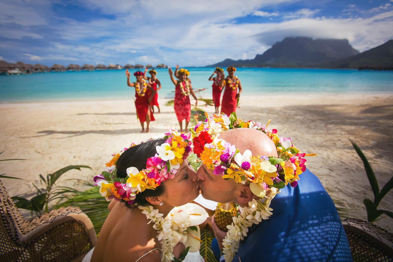 Four Seasons Bora Bora Wedding - Kissing the bride