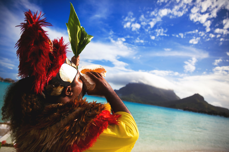 Four Seasons Bora Bora Wedding - Blowing the Horn