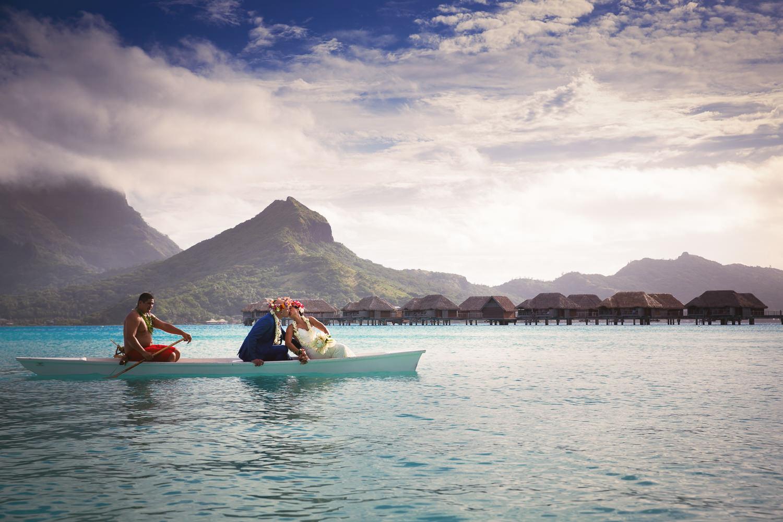 Four Seasons Bora Bora Wedding - Being rowed back together