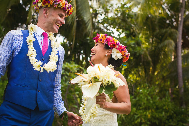 Four Seasons Bora Bora Wedding - Laughing together as newly weds