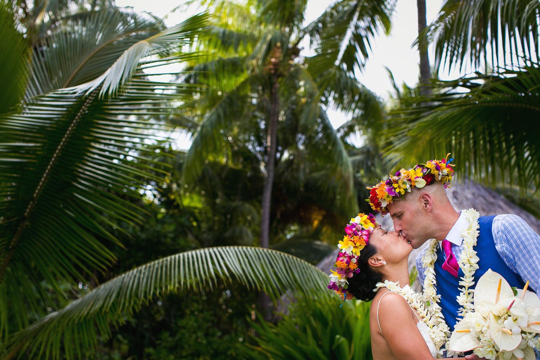 Four Seasons Bora Bora Wedding - Kissing under the palms