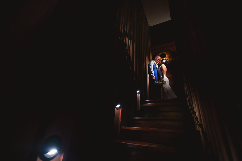 Four Seasons Bora Bora Wedding - Spotlight of newly weds embracing