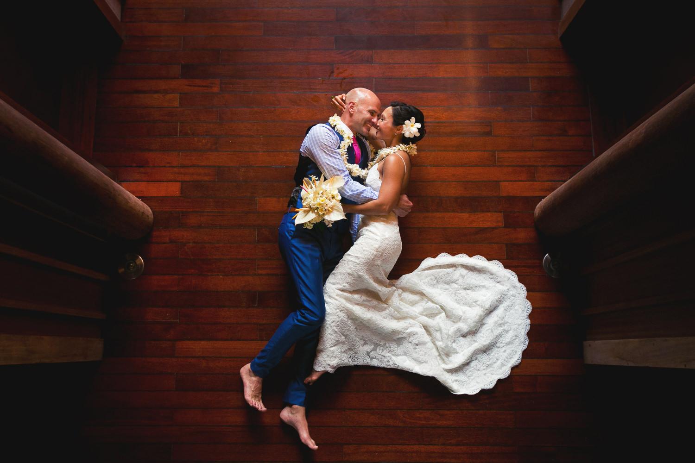Four Seasons Bora Bora Wedding - Embracing on the hard wood floor