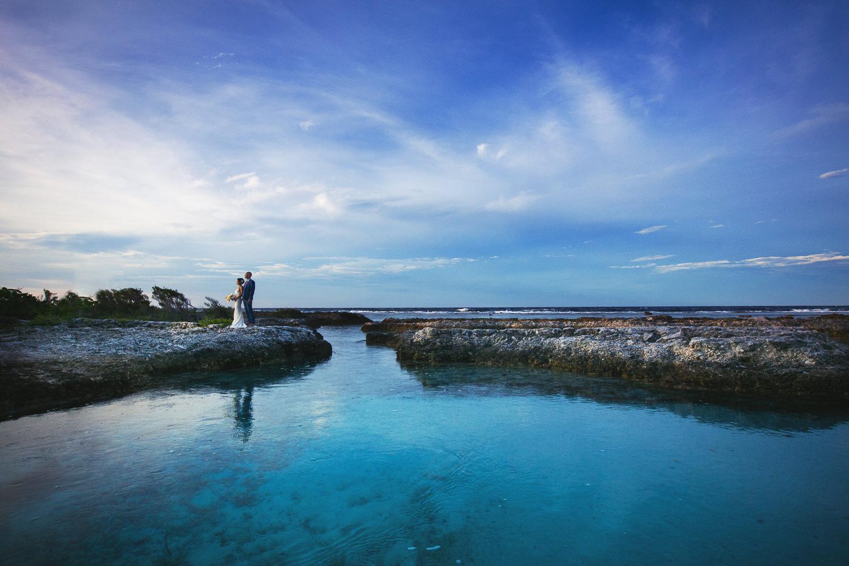 Four Seasons Bora Bora Wedding - Gorgeous sky lighting them holding each other
