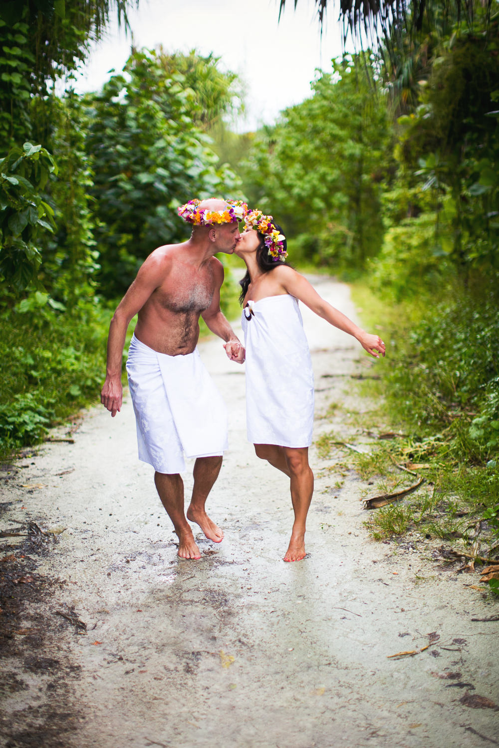 Four Seasons Bora Bora Wedding - Great shot of newly weds kissing in their towels