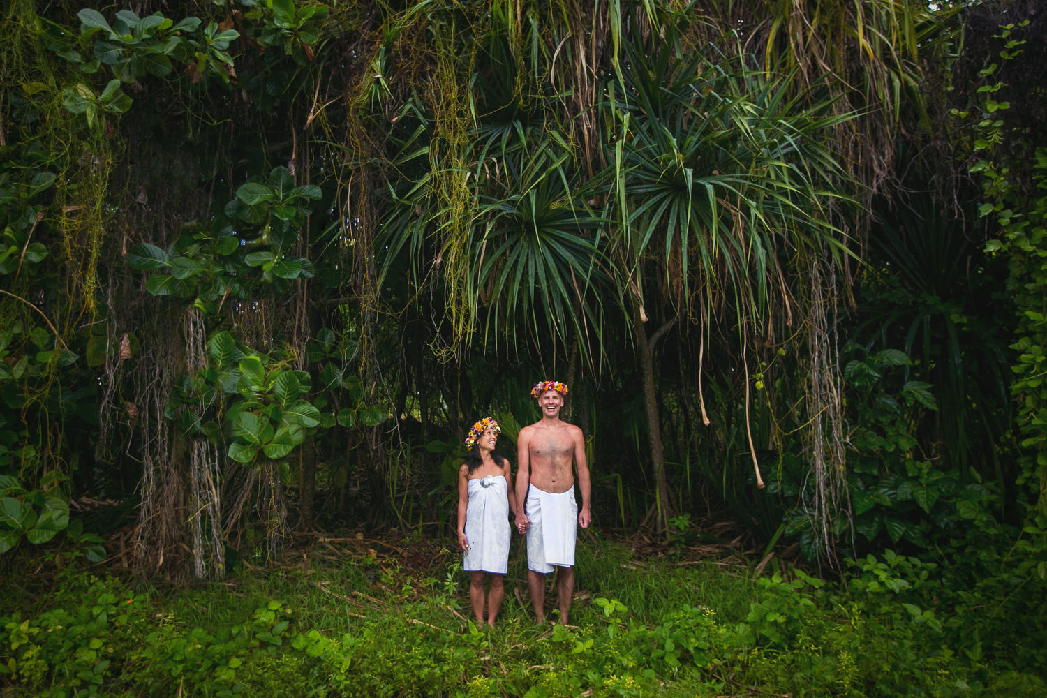 Four Seasons Bora Bora Wedding - Hand in hand in the tropical forest