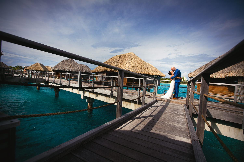 Four Seasons Bora Bora Wedding - Bride and Groom Kissing