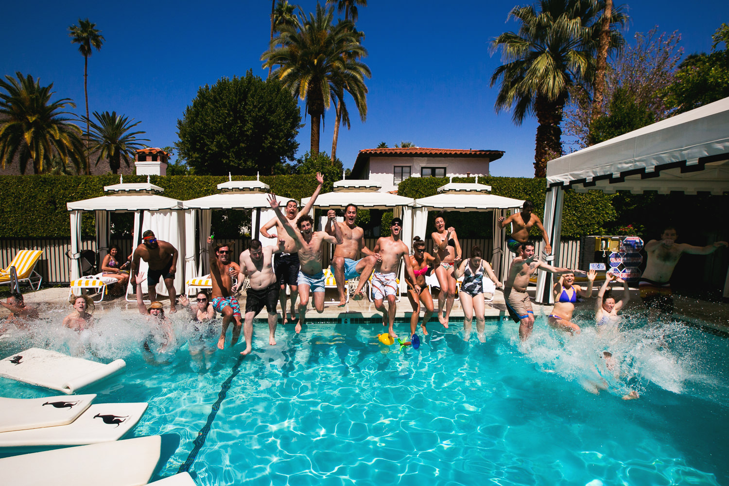 Avalon Palm Springs Photographer - Family and guests jumping into the pool