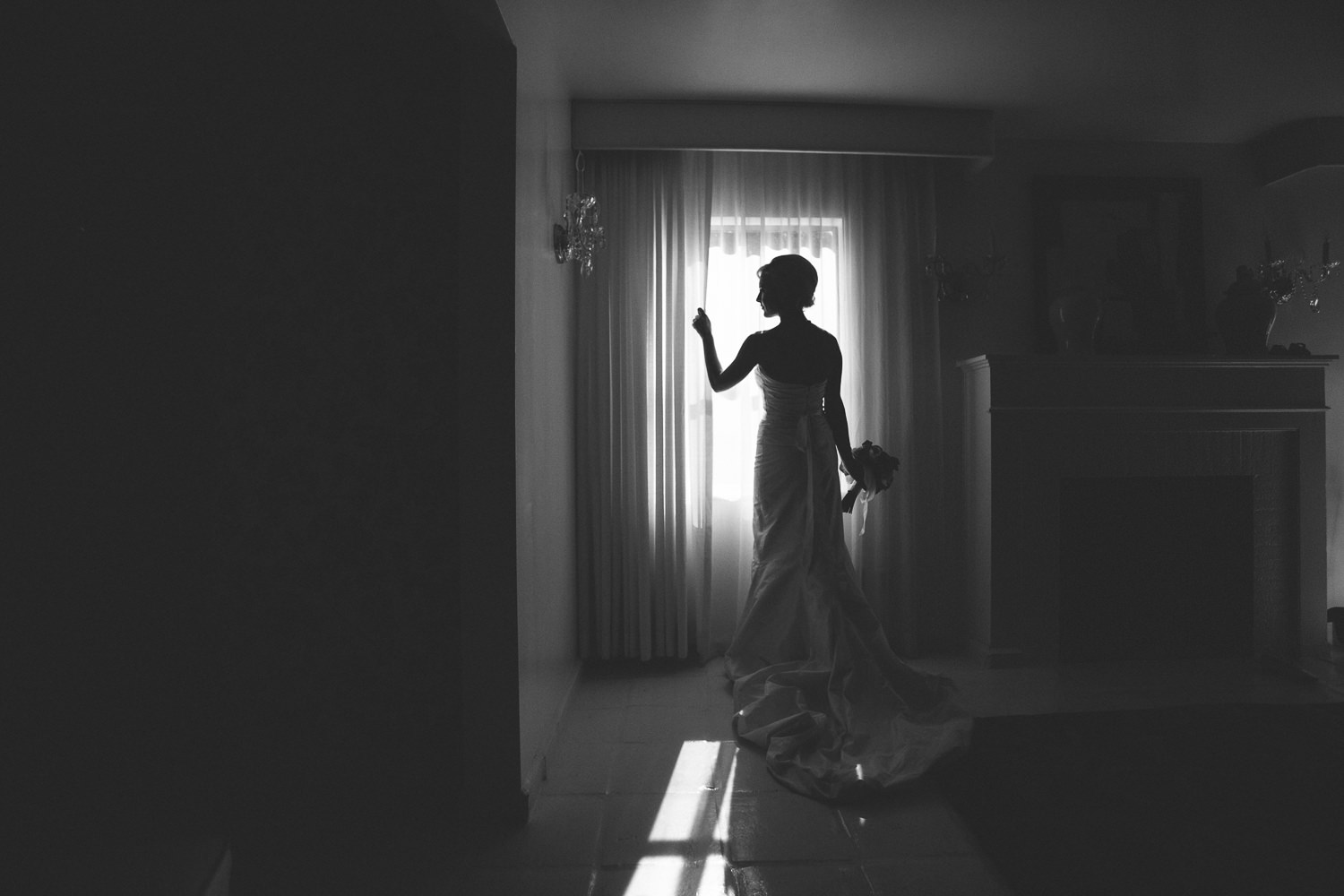 Avalon Palm Springs Photographer - Gorgeous bride lit by the window light in black and white