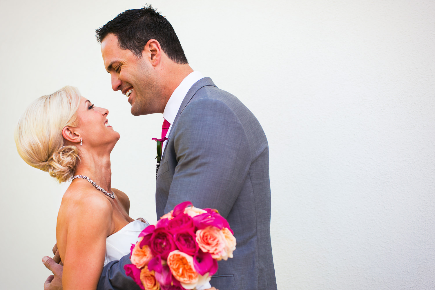 Avalon Palm Springs Photographer - Bride and Groom holding each other