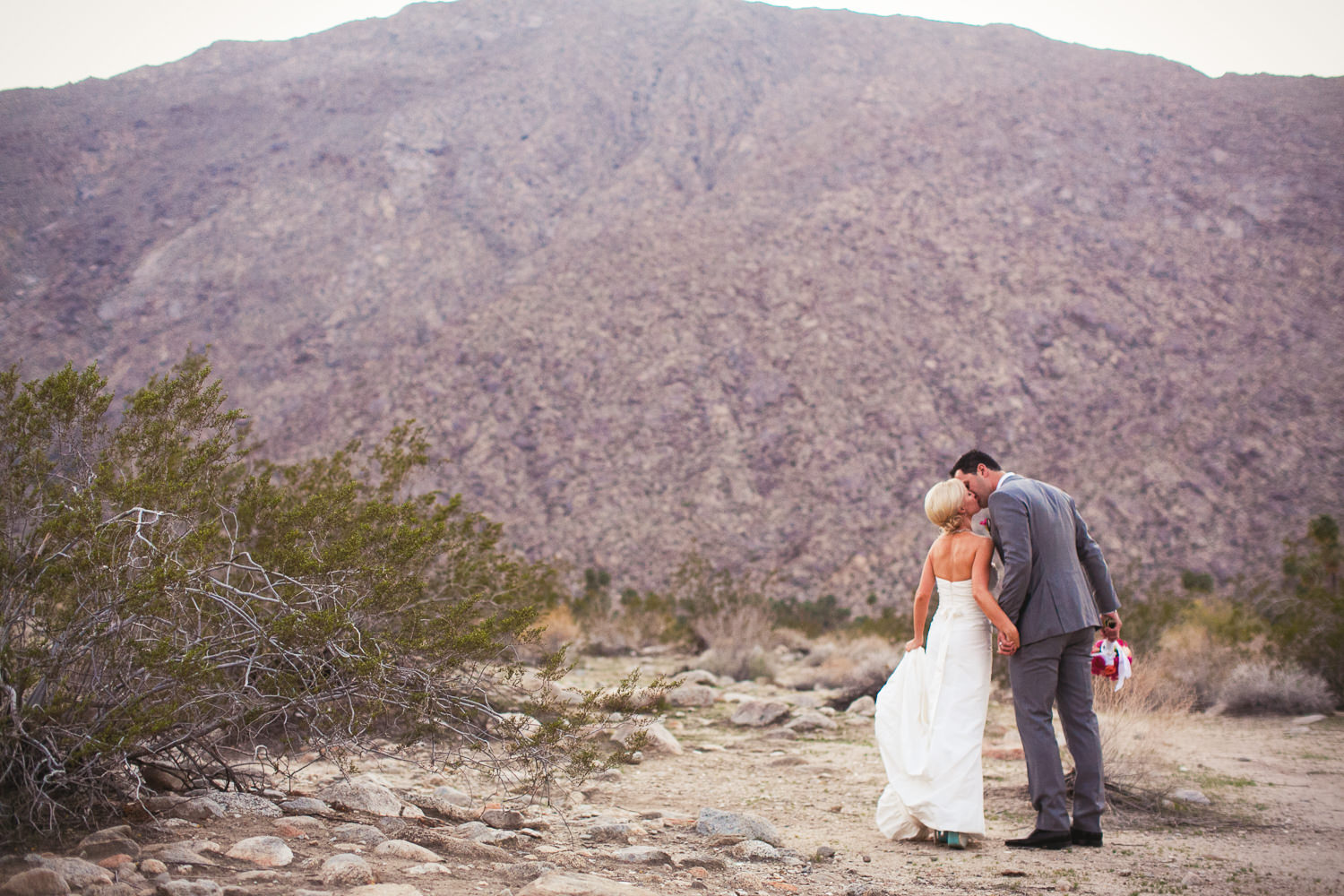 Avalon Palm Springs Photographer - Kissing with the mountains as a backdrop