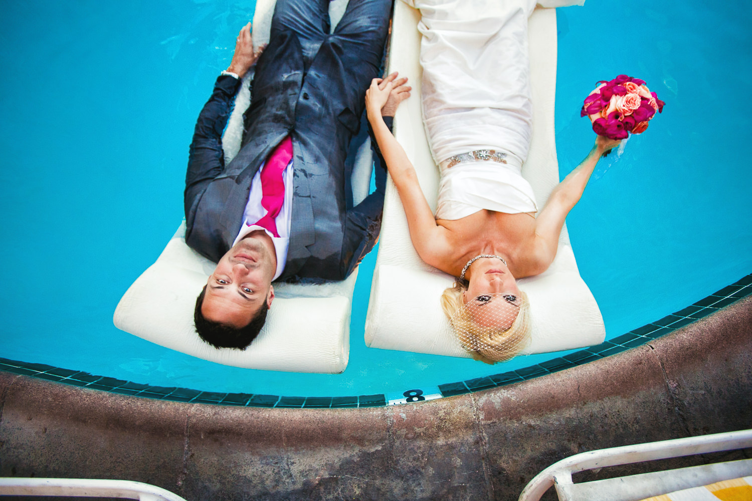 Avalon Palm Springs Photographer - Holding hands in the pool fully dressed