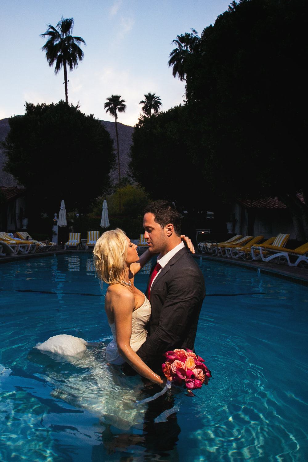 Avalon Palm Springs Photographer - Embracing in the pool fully dressed
