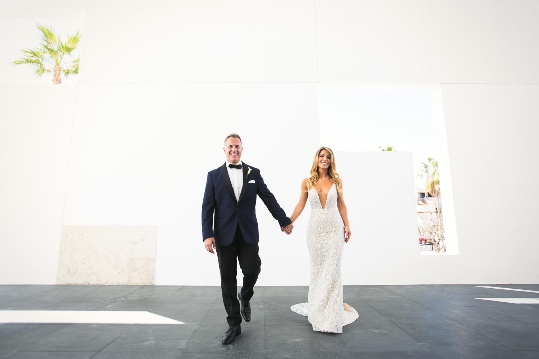 Viceroy Los Cabos Wedding - Bride and groom walking hand in hand