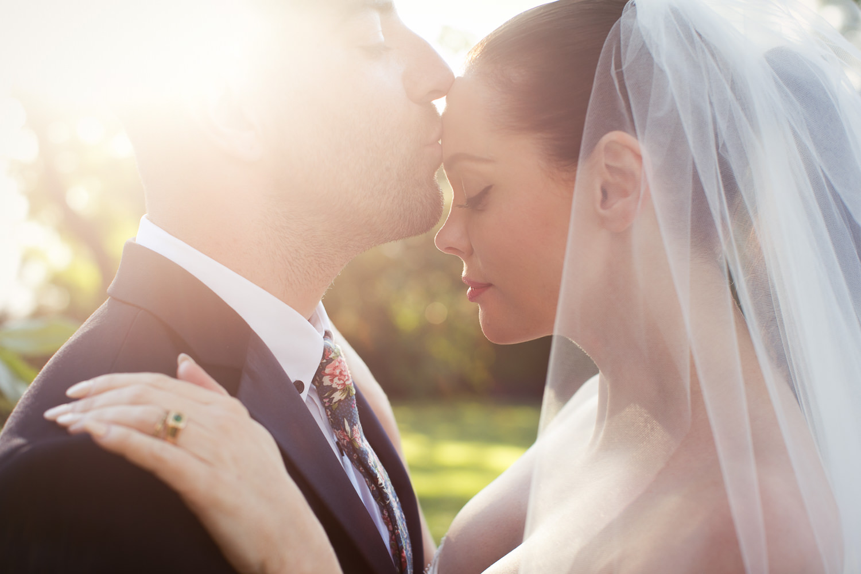 Rose McGowan Wedding at Paramour Estate - Groom kissing his bride