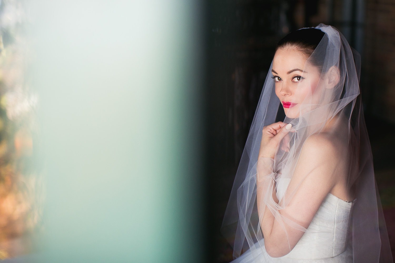 Rose McGowan Wedding at Paramour Estate - Bride standing in balcony doorway