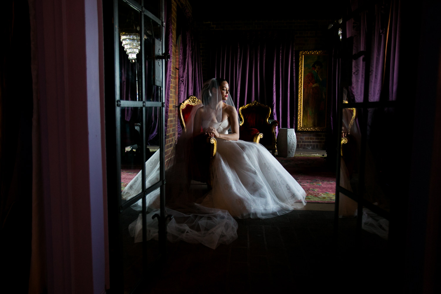 Rose McGowan Wedding at Paramour Estate - Bride in her dress on her chair