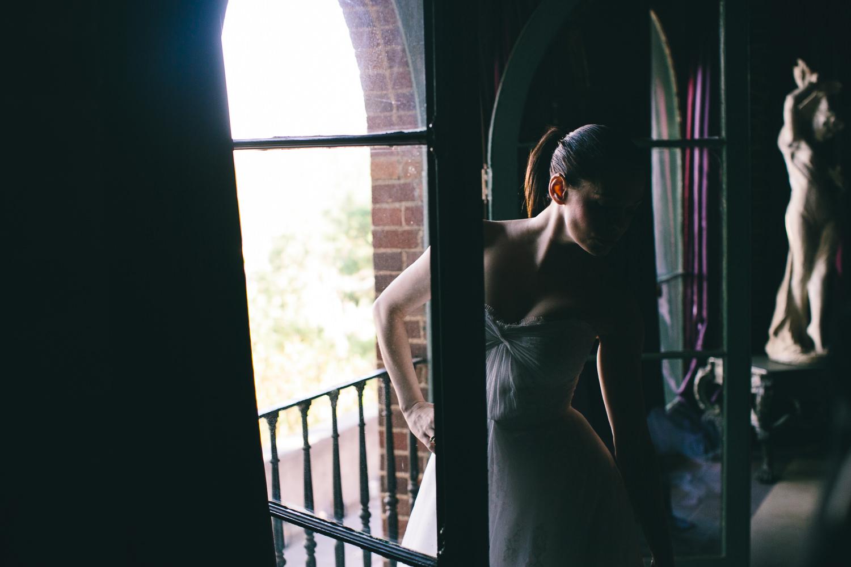 Rose McGowan Wedding at Paramour Estate - Bride through the window pane