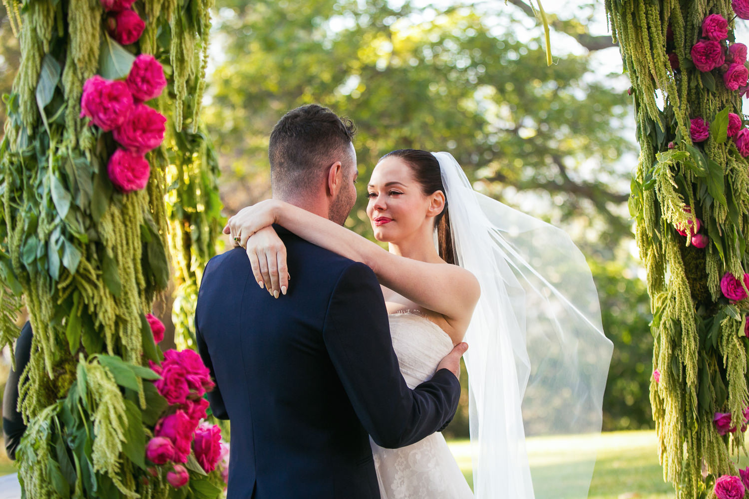 Rose McGowan Wedding at Paramour Estate - Bride and groom embracing