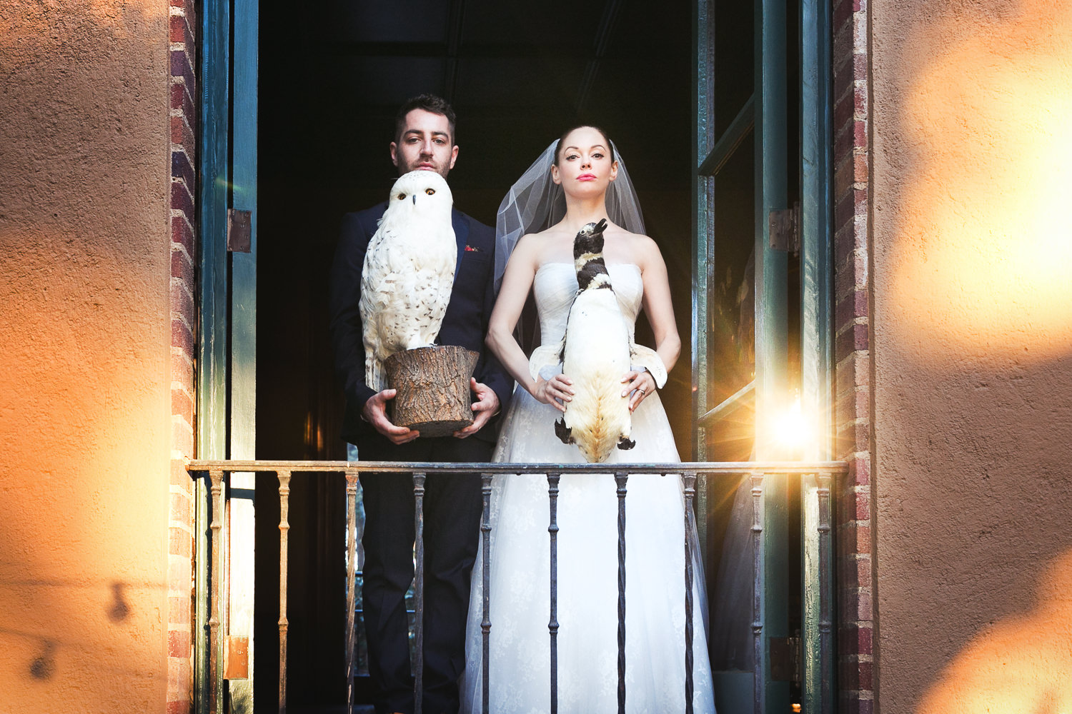 Rose McGowan Wedding at Paramour Estate - On the balcony holding stuffed birds in great shot