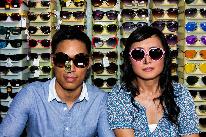 Venice Beach Engagement Photos - Trying on sunglasses