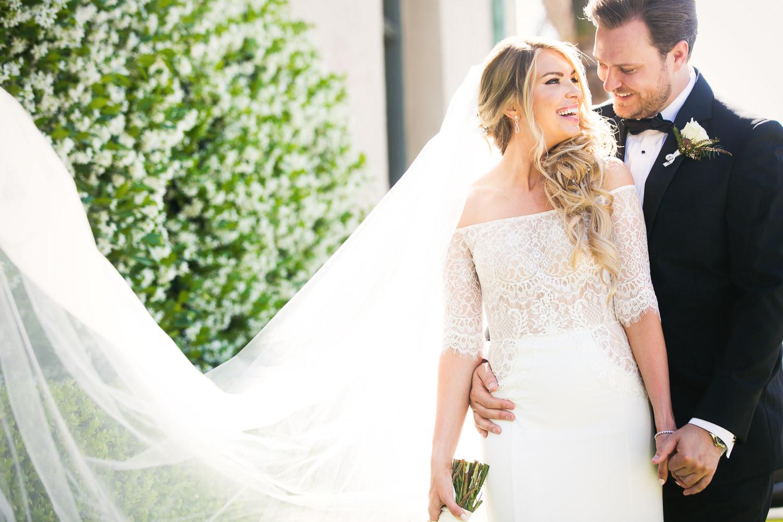 Ebell Long Beach Wedding - Bride walking with groom outside