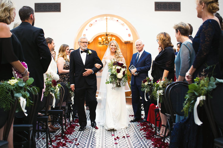 Ebell Long Beach Wedding - Bride walking down the aisle
