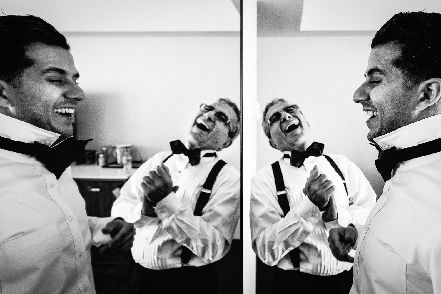 Groom getting ready with his Dad and laughing at the Le Meridien for his Bently Reserve Wedding