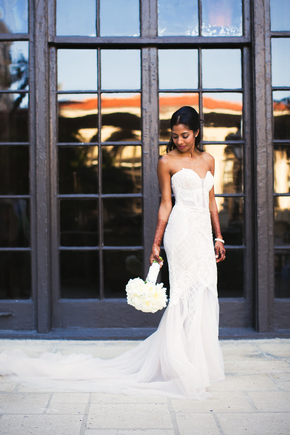 Bride alone in the courtyard at her Breakers Palm Beach Wedding