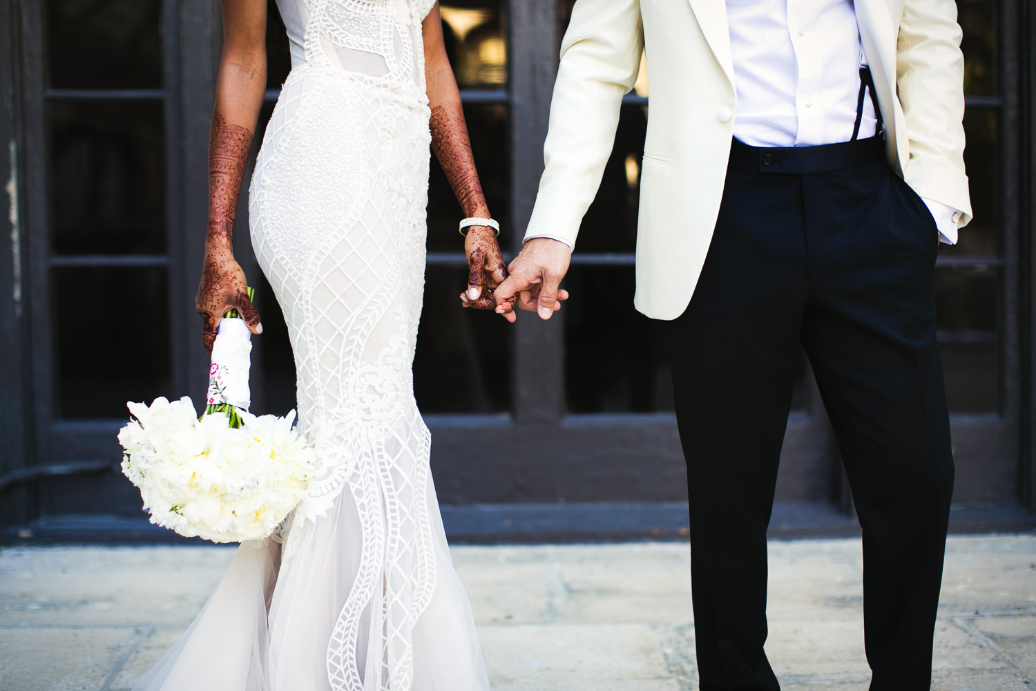 Holding hands at their Breakers Palm Beach Wedding