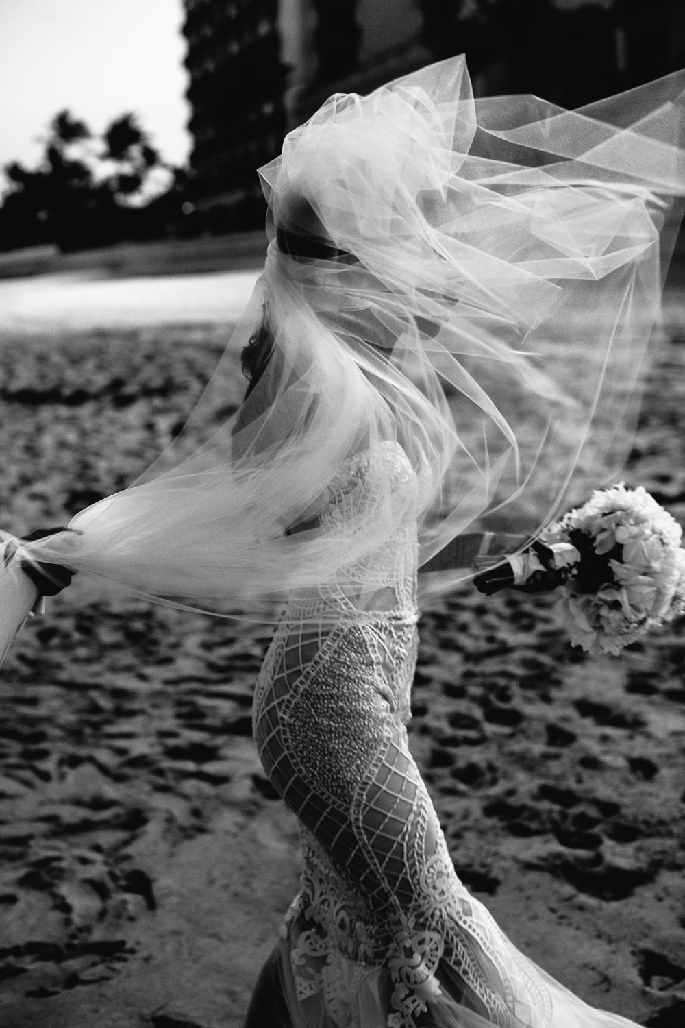 Breakers Palm Beach Wedding Black and White Beach Photo of bride with veil in the wind