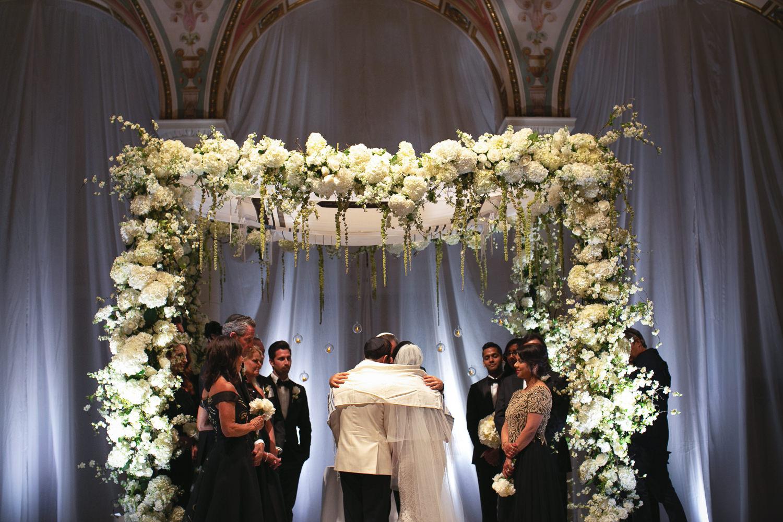 Under the chuppah at their Breakers Palm Beach Wedding