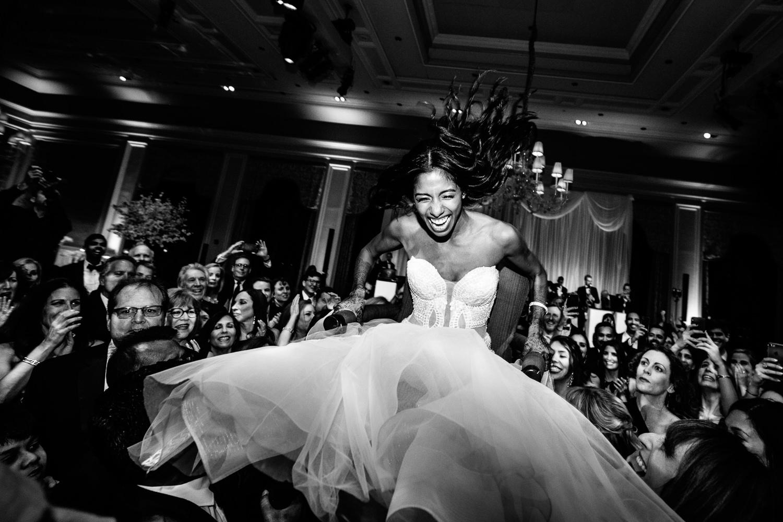 Amazing Breakers Palm Beach Wedding Jewish Hora Bride in the air