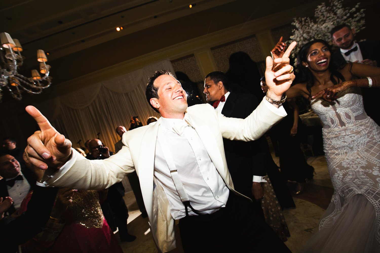 White Tuxedo Jacket Groom dancing at his Breakers Palm Beach Wedding