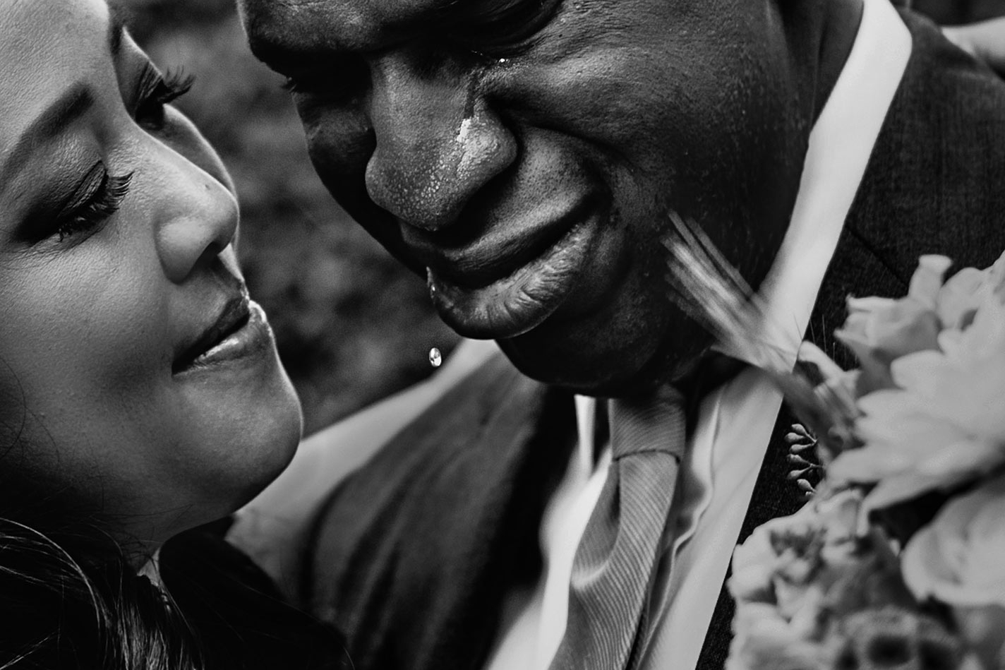 Emotional Los Angeles wedding moment of African-American groom crying
