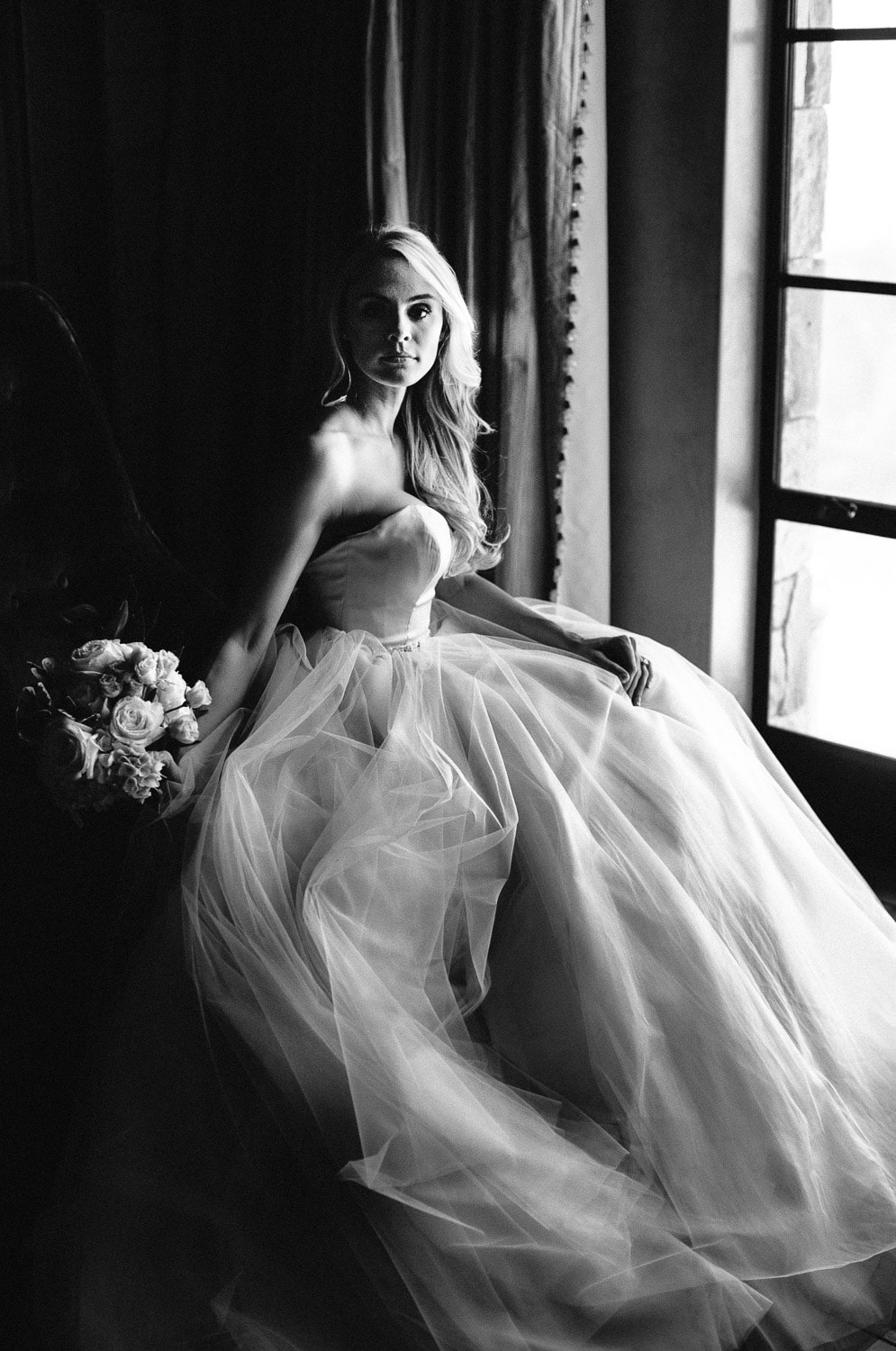 Portrait of a beautiful bride sitting be the window at her Malibu Rocky Oaks wedding