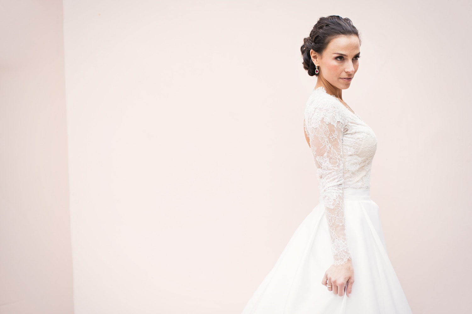 Glamorous Monique Lhuillier wedding gown with sleeves and pockets at the Hotel Bel-Air