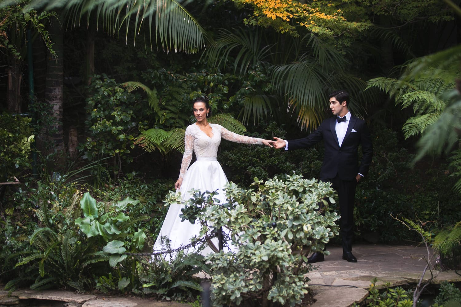 wedding photo by the swans at Hotel Bel-Air