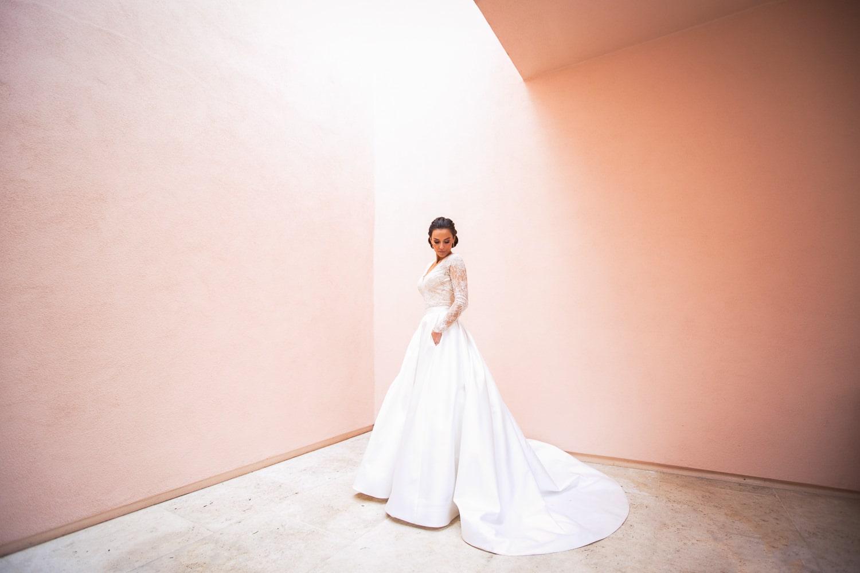 Bride photo at a pink wall at her Hotel Bel-Air wedding