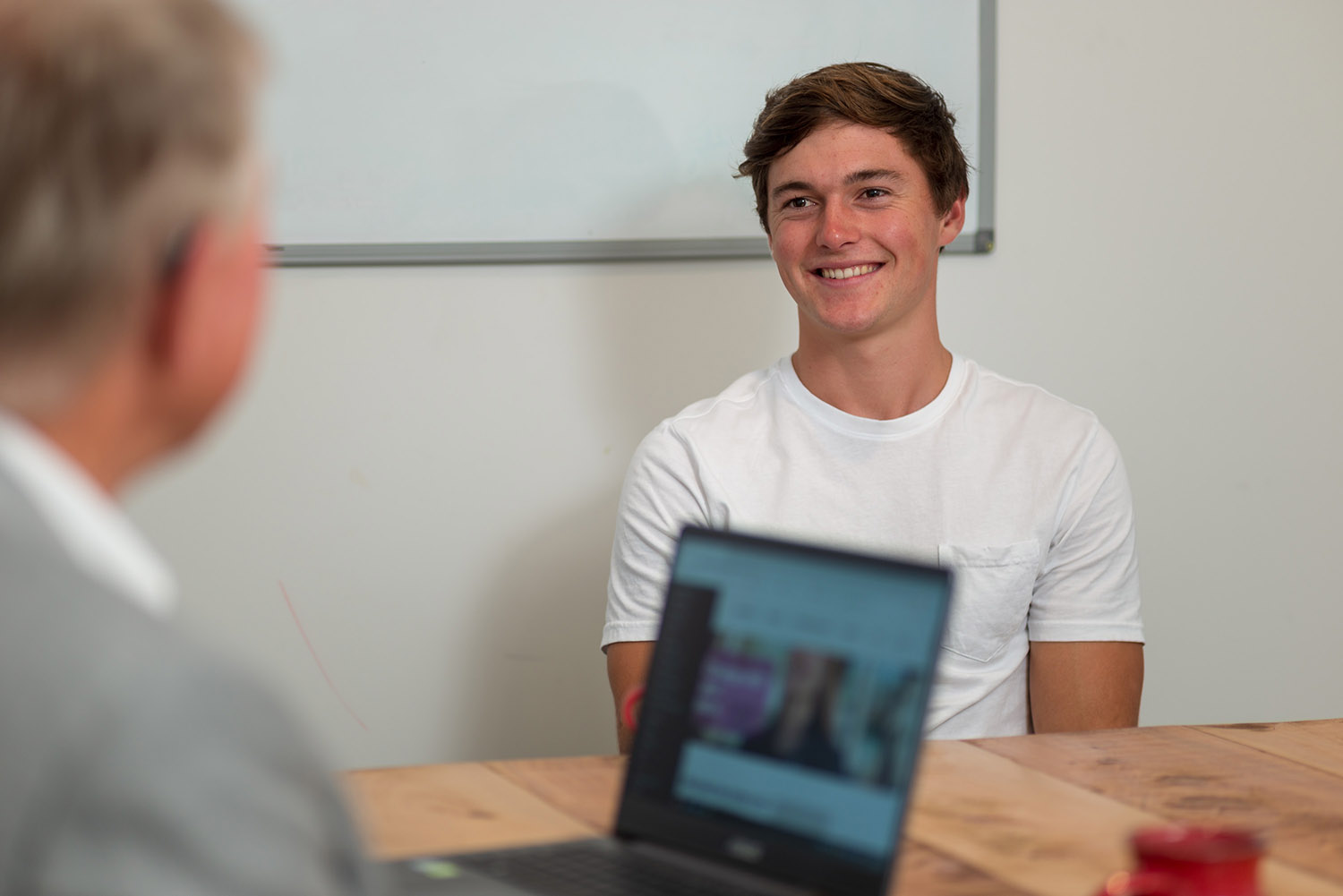 Stephen and mature male student in a training room discussing career options in a career planning session