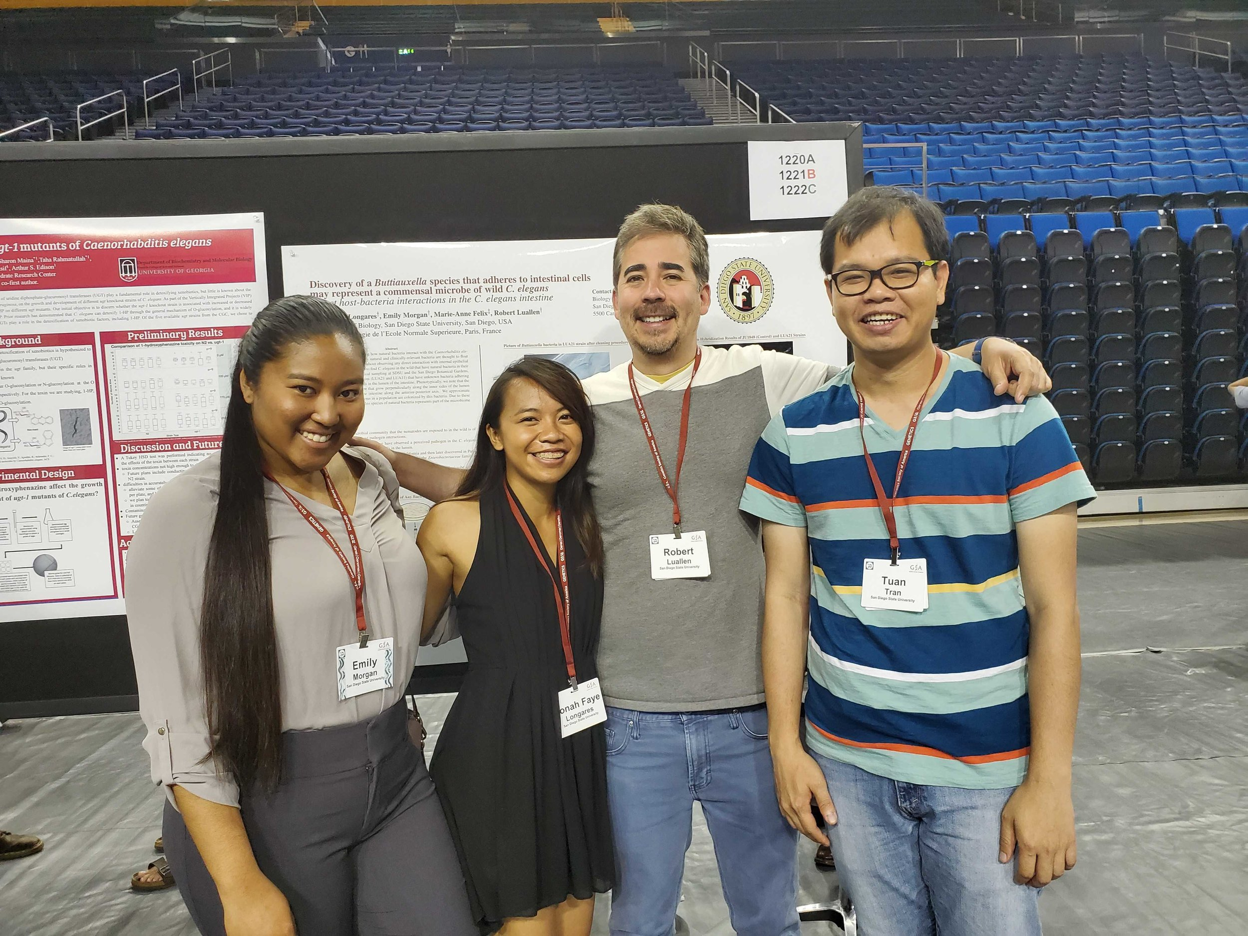 The Luallen Lab in front of Jonah Faye Longares' poster at the 22nd International C. elegans meeting