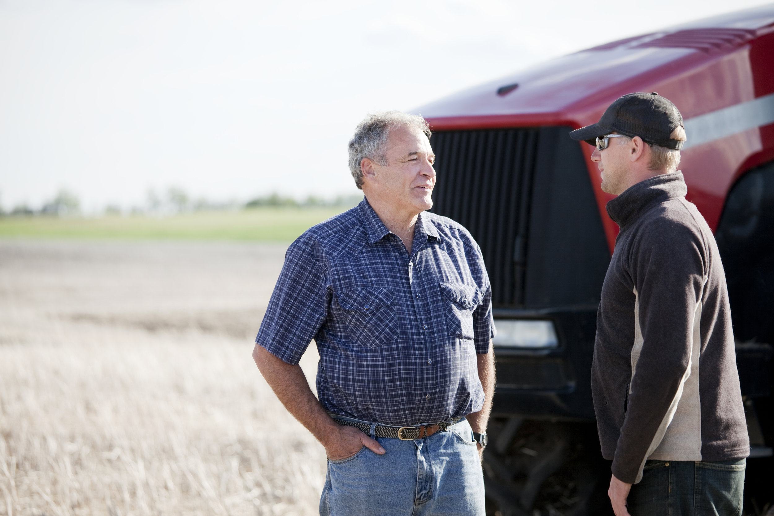 iStock-157609206 - farmers talking in front of tractor.jpg