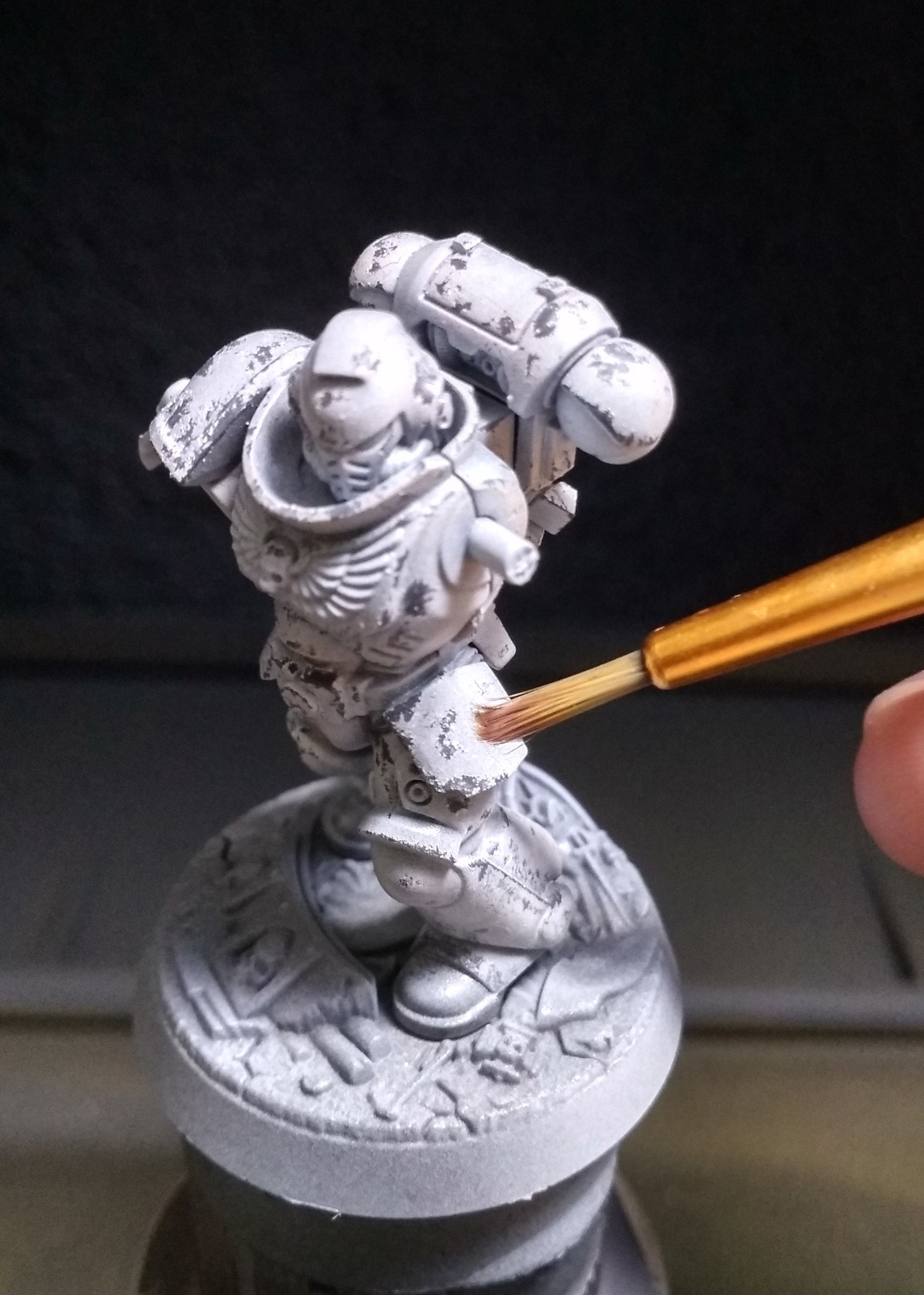 - On larger surfaces, you can add some chipping to represent battle damage. Using the tip of the wet brush stipple on the Dead White surface and dab a bit of the layer away.