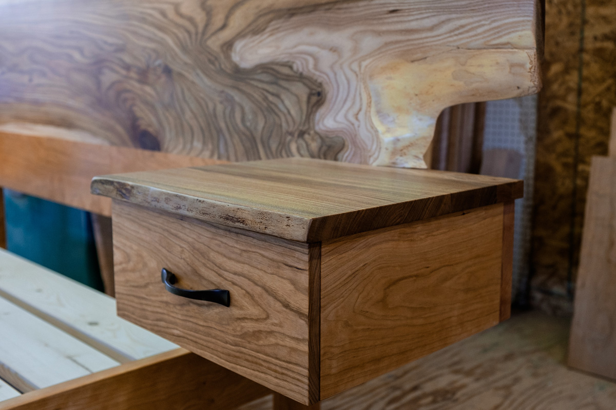 Night stand cubby detail with elm top, the boxes are detachable from the headboard for easier transport.