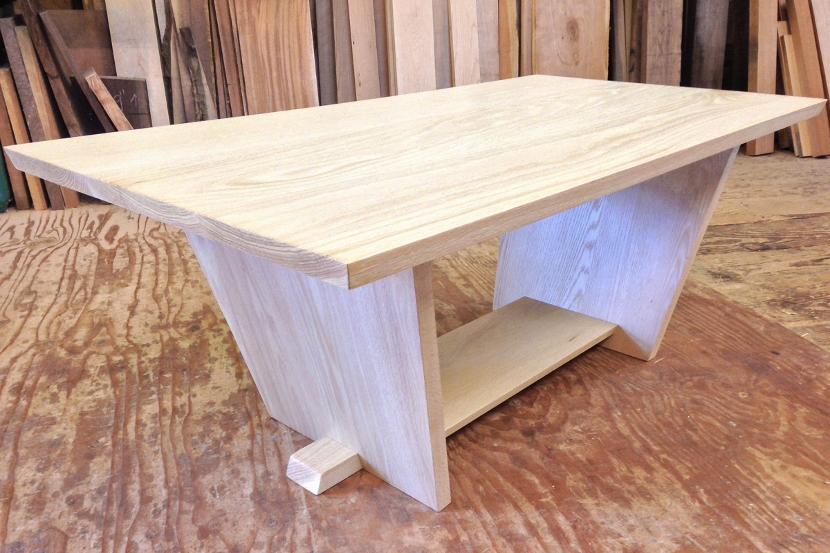A bleached white oak coffee table, with a lower shelf.