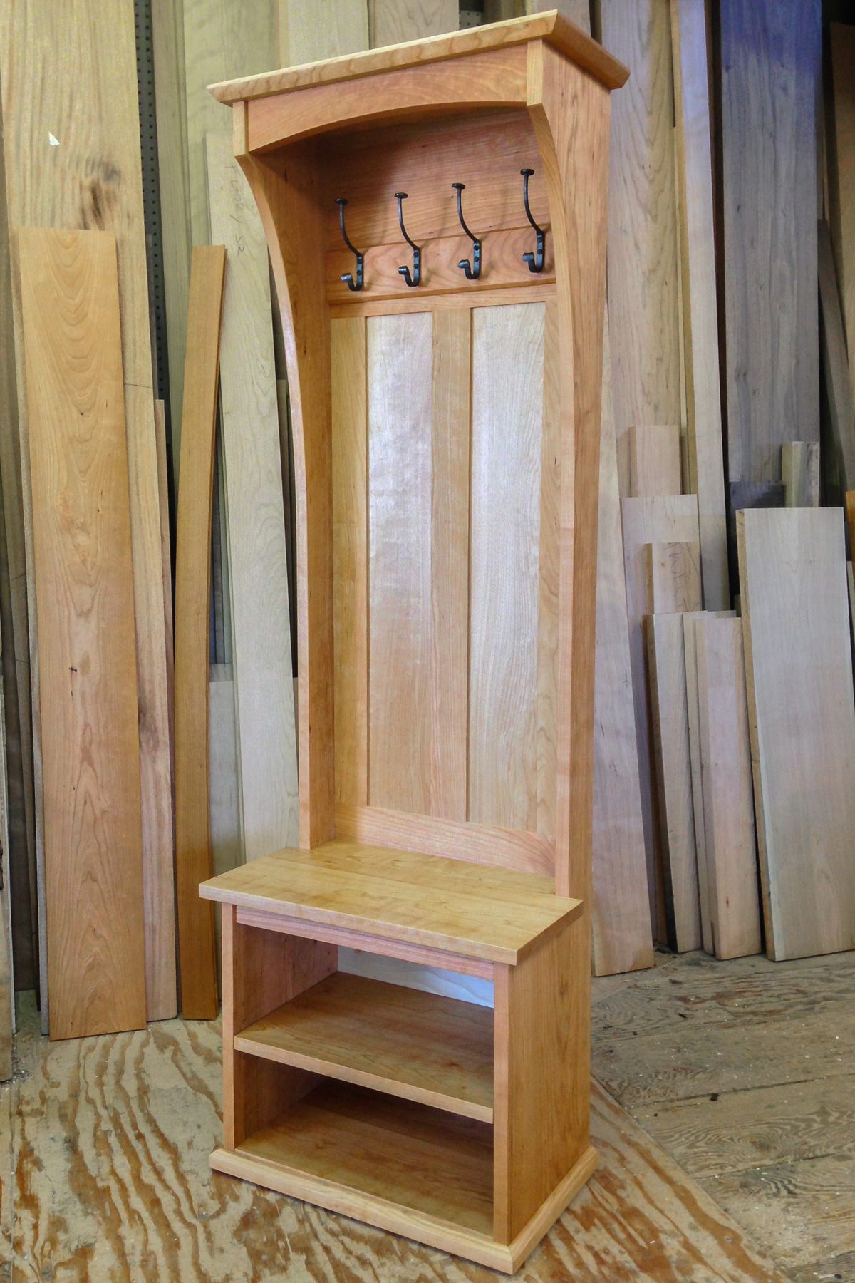 Cherry hall tree with built in bench and adjustable shoe shelf.